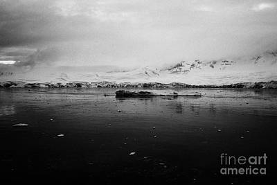 Fournier Photograph - floating ice and snow covered landscape in Fournier Bay on Anvers Island Antarctica by Joe Fox