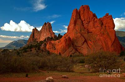 Photograph - Fluffy Clouds Over Jagged Peaks by Adam Jewell