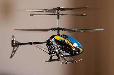 Flying Rc Helicopter Art Print by Alex Grichenko