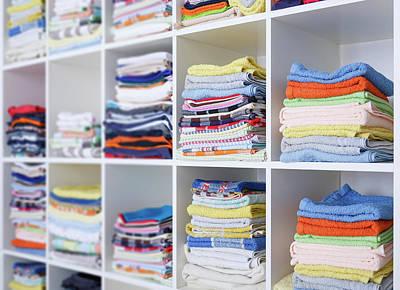Folded Towels On Shelves Art Print by Wladimir Bulgar