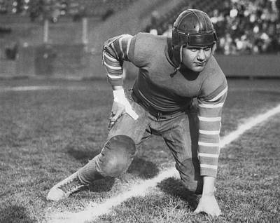 Black Commerce Photograph - Football Fullback Player by Underwood Archives