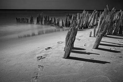 Mellow Yellow - Footprints in the Sand among the Pilings by Randall Nyhof