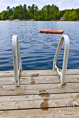 Swim Ladder Photograph - Footprints On Dock At Summer Lake by Elena Elisseeva