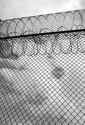Photograph - Forbidding Prison Fence by John Orsbun