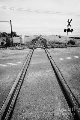 former canadian pacific railway now great sandhills railway crossing highway through leader Saskatch Art Print by Joe Fox