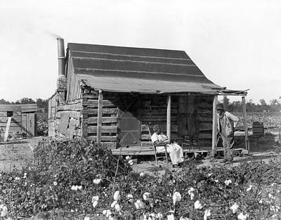 Old Log Cabin Photograph - Former Slaves At Their Cabin by Underwood Archives