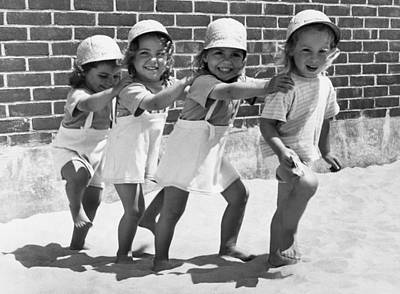 Beach Scenes Photograph - Four Little Girls Having Fun by Underwood Archives