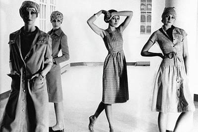 Four Models Standing In A Hallway Art Print by Deborah Turbeville