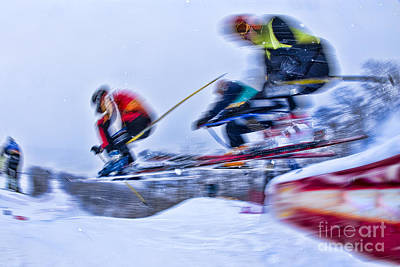 Photograph - Four Ski Racers Going Over A Jump. by Don Landwehrle