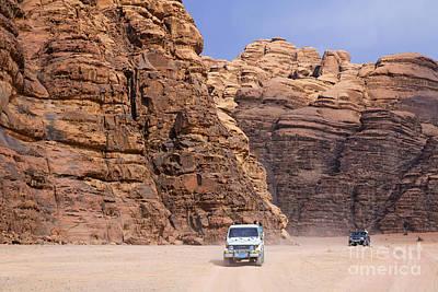 Four Wheel Drive Vehicles At Wadi Rum Jordan Art Print by Robert Preston