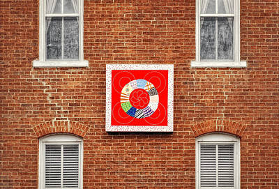 Photograph - Framed Quilt On Brick Wall Of Jail by Frank J Benz