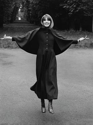 Hardy Photograph - Francoise Hardy Wearing A Coat With A Small Cape by Arnaud de Rosnay