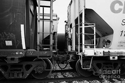 freight grain trucks coupling on canadian pacific railway Saskatchewan Canada Art Print by Joe Fox