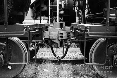 freight grain trucks coupling on former canadian pacific railway Saskatchewan Canada Art Print by Joe Fox