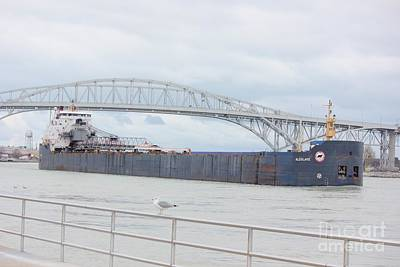 Photograph - Freighter Passing Under Bluewater Bridge In Port Huron Michigan by Bill Woodstock