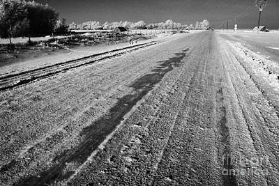 frozen salt and grit covered rural small road in Forget Saskatchewan Canada Art Print by Joe Fox
