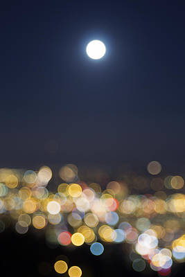 Food And Flowers Still Life Rights Managed Images - Full Moon Rise Over Blurred City Lights Royalty-Free Image by Jit Lim