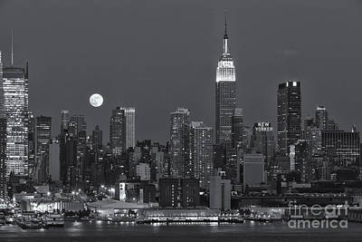Photograph - Full Moon Rising Over New York City Iv by Clarence Holmes