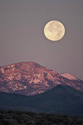 Ditto Photograph - Full Moon Setting Over Snow-covered by Larry Ditto