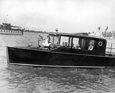 Yacht Photograph - Gar Wood At The Helm by Underwood Archives