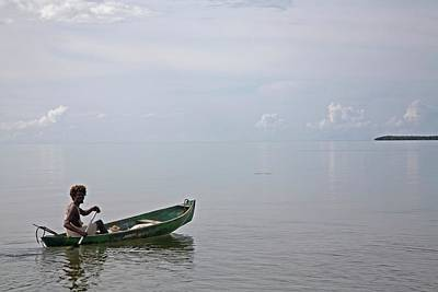 Canoe Photograph - Garifuna Fisherman by Jim West