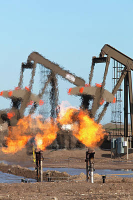 Oil Industry Photograph - Gas Flares At An Oil Field by Jim West
