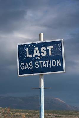 Grey Clouds Photograph - Gas Station Roadsign by David Parker