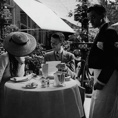 Tableware Photograph - Gaston De Clairville At Lunch With A Woman by Roger Schall