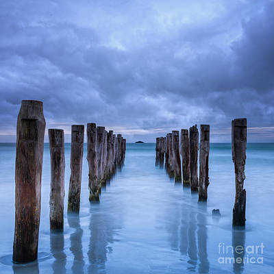 New Zealand Photograph - Gathering Storm Clouds Over Old Jetty by Colin and Linda McKie