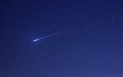 Geminid Meteor Art Print by Luis Argerich
