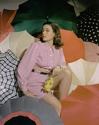 Bare Midriff Photograph - Gene Tierney Amongst Umbrellas by Horst P. Horst