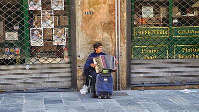 Photograph - Genoa Street Musician by Herb Paynter