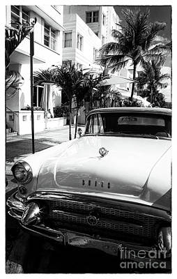 Photograph - Getaway In South Beach by John Rizzuto