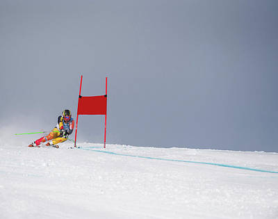 Skiing Photograph - Giant Slalom Skier Rounds Gate At High by Ascent Xmedia