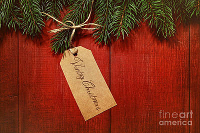Photograph - Gift Tag On Red Wood Background by Sandra Cunningham