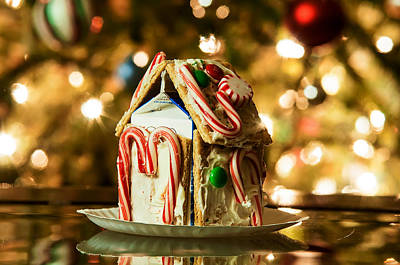 Photograph - Gingerbread House Against A Background Of Christmas Tree Lights by Alex Grichenko