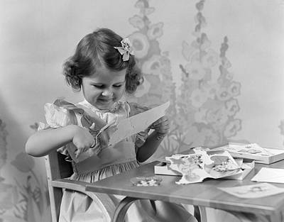 Girl Cutting Paper, C.1940s Print by H. Armstrong Roberts/ClassicStock