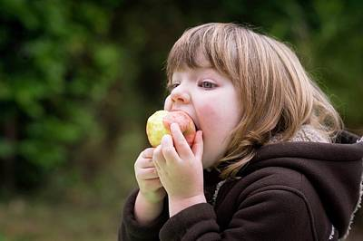 Healthy Eating Photograph - Girl Eating An Apple by Aberration Films Ltd