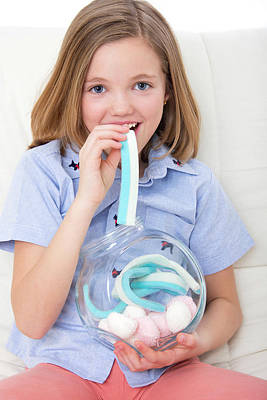 Candy Jar Photograph - Girl Eating Candy by Lea Paterson