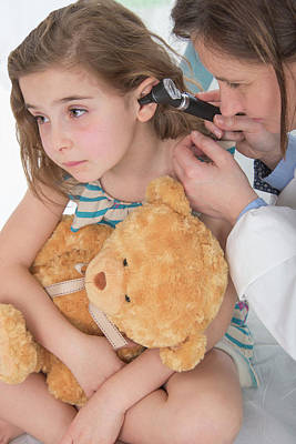 Child Care Photograph - Girl Having Her Ears Examined by Lea Paterson