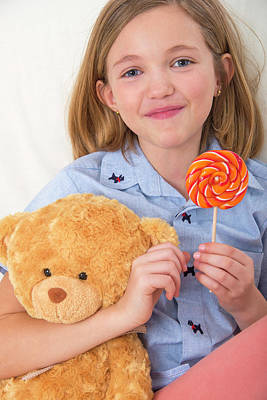 Girl Holding Lollypop And Teddy Bear Art Print by Lea Paterson