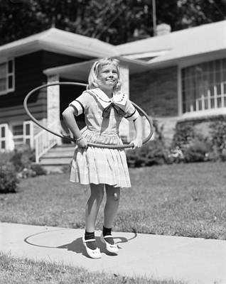 Girl Hula-hooping, C.1950s Art Print by H. Armstrong Roberts/ClassicStock