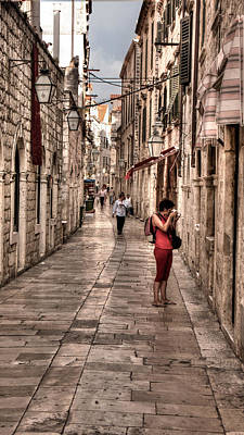 Photograph - Girl In Red In The White Streets Of Dubrovnik by Weston Westmoreland
