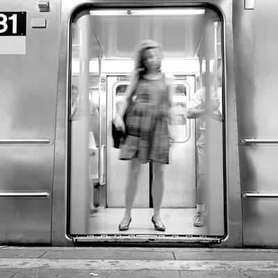 Photograph - Girl In Subway Door by Dave Beckerman