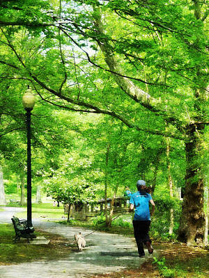 Jogging Photograph - Girl Jogging With Dog by Susan Savad
