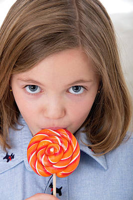 Girl Licking A Lollypop Art Print by Lea Paterson