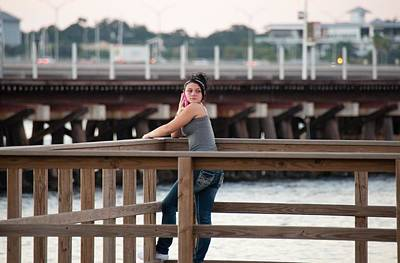 Photograph - Girl On A Pier by John Black
