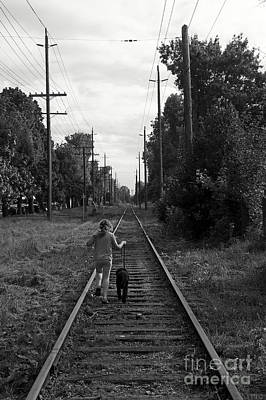 Photograph - Girl On The Train Tracks by John  Mitchell