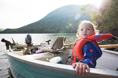 Harrison Hot Springs Wall Art - Photograph - Girl Sitting In Motorboat With Life by Christopher Kimmel