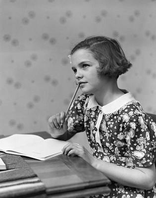 Photograph - Girl Thinking Over Homework, C.1930s by H. Armstrong Roberts/ClassicStock